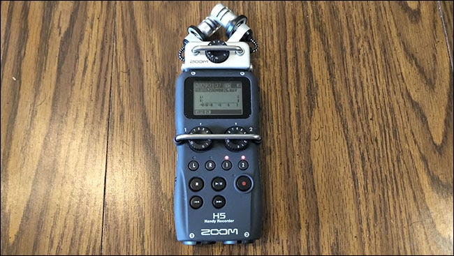 A Zoom H5 Recorder on a table.