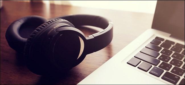 Wireless headphones next to a computer