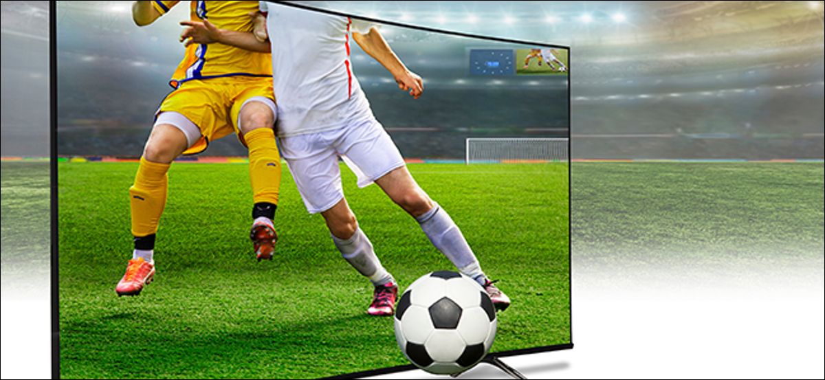 A couple of athletes play soccer on a 4K TV.