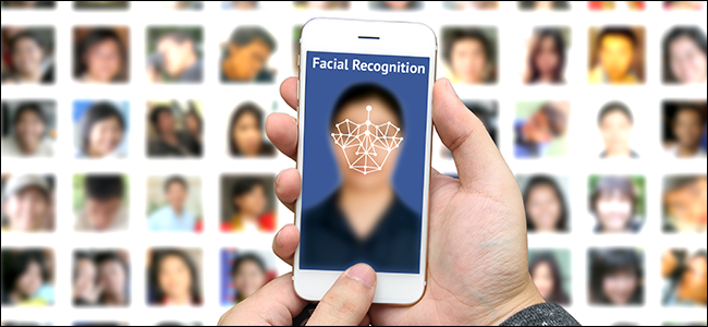 A man using facial recognition tech to identify a subject from a database.