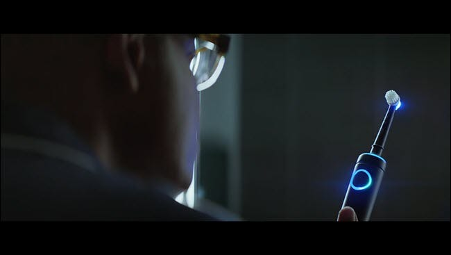 Man from Alexa commercial staring at his lit-up Echo toothbrush.