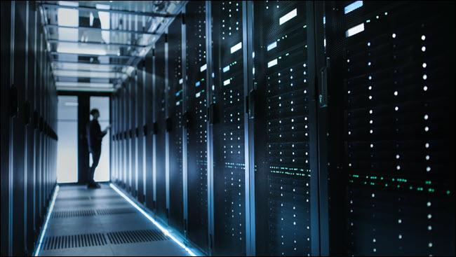 A man standing in a data center.