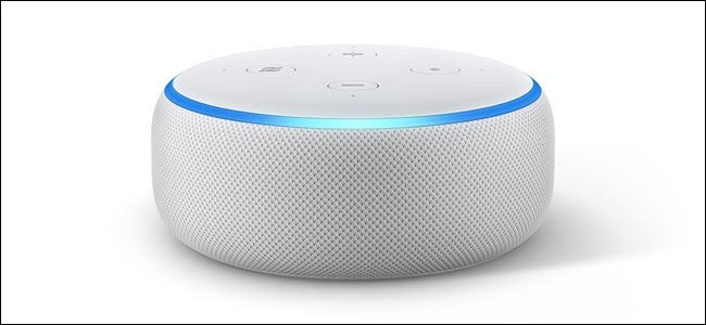 Amazon Echo dot 3 with the light blue LED ring lit up.