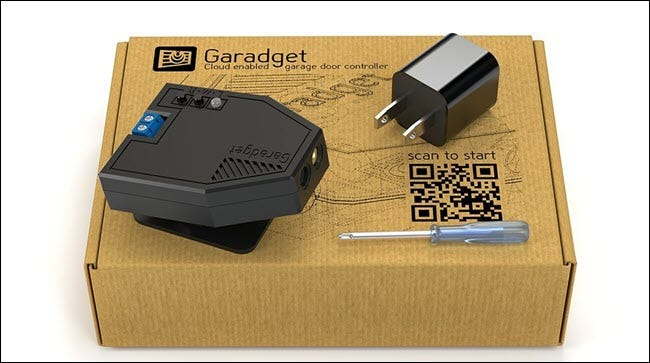 A Garadget box, with laser, plug, and screwdriver.
