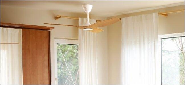 A Haiku Smart fan hanging from a ceiling