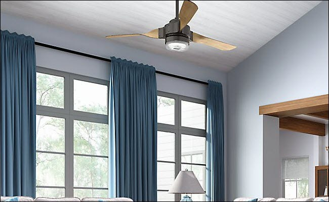 A Hunter smart fan hanging from the ceiling.