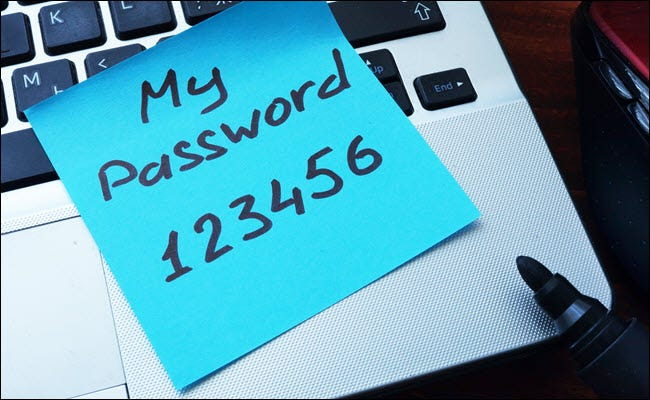 My Password123456 written on a post-it note and stuck to a computer.