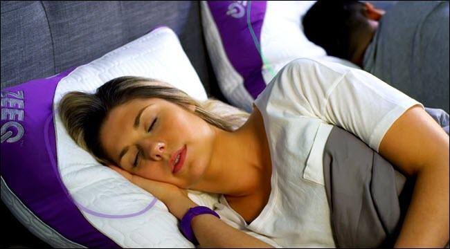 Woman sleeping on a ZEEQ Smart pillow