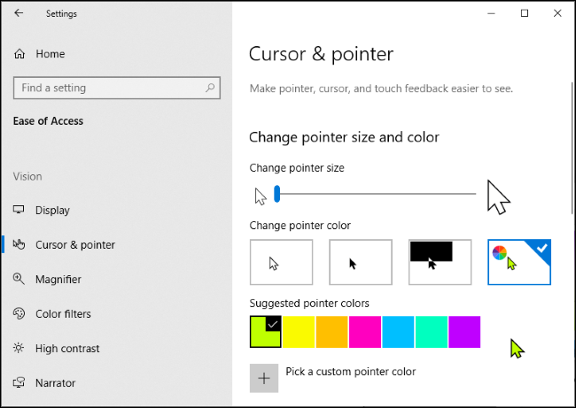 Custom mouse pointer color selection in Windows 10's Settings app with the green cursor selected.
