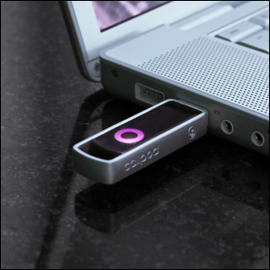 A USB Bluetooth dongle plugged into a laptop computer
