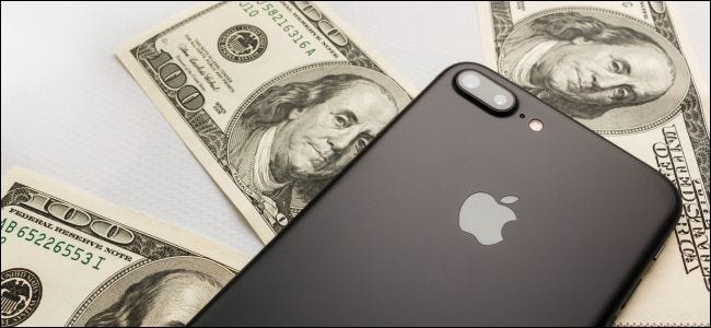 iPhone 8s Plus lying on top of three $100 bills.