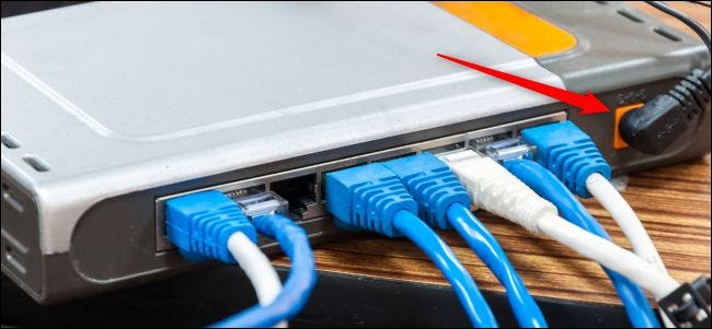 Power and cable connections on the back of a router.