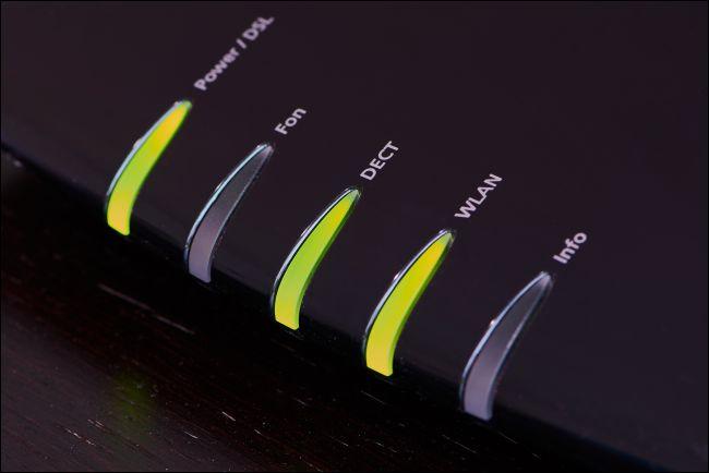 Green status lights on a modem.