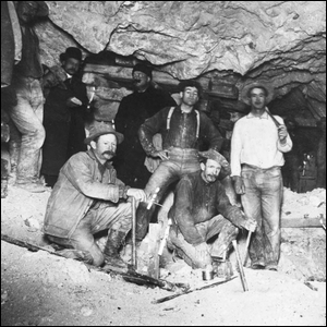 Miners resting in a mineshaft, possibly contemplating whether or not they had reached China