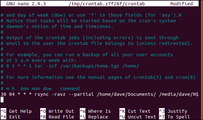 crontab open in nano in a terminal window