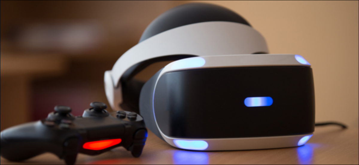 PlayStation VR headset, PlayStation 4 console, and controller sitting on a table.