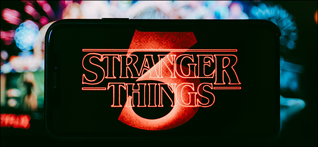 The Stranger Things logo against a blurry, colorful background.