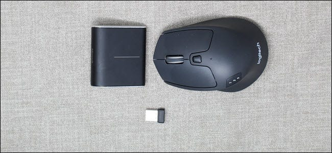 A Microsoft Wedge Bluetooth mouse next to a Logitech M720 RF Mouse.