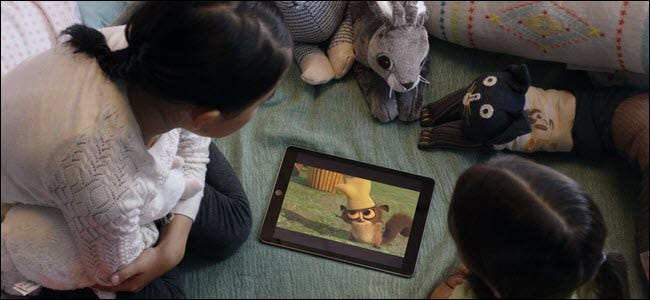 Children watching a film on an iPad.