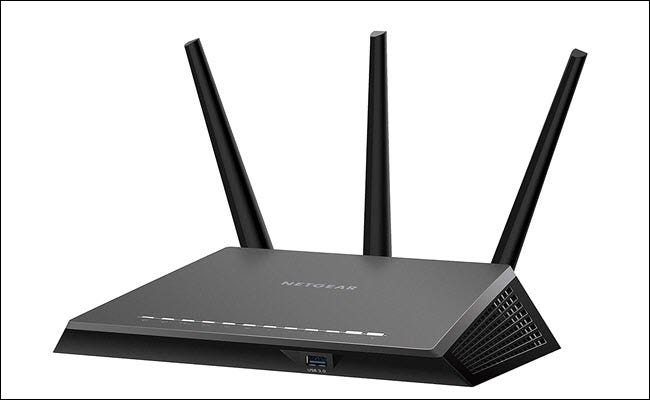 A Netgear Nighthawk R7000P with all three antennas up.