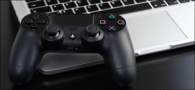 Sony's DualShock 4 wireless controller with a MacBook