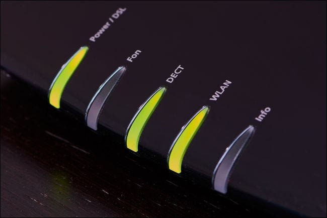 Green status lights on a modem.