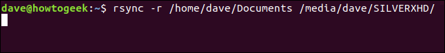 rsync -r /home/dave/Documents /media/dave/SILVERXHD/ in a terminal window