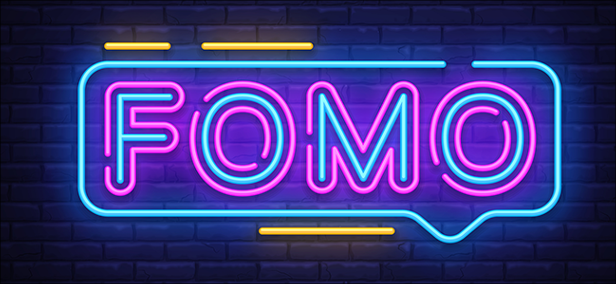 The word FOMO presented in big, bold, neon letters.