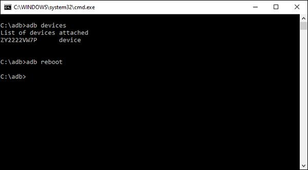 An Android Debug Bridge (ADB) reboot command on a Windows computer.
