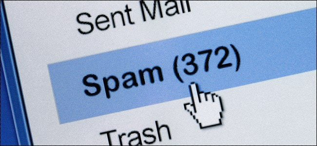 A mouse pointer hand clicking a Spam folder in an email client.