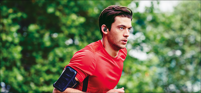 Man running with Bluetooth earbuds on.