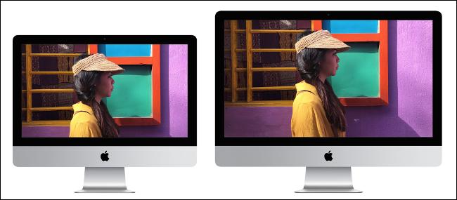 A 21-inch Apple iMac sitting next to a 27-inch Apple iMac.