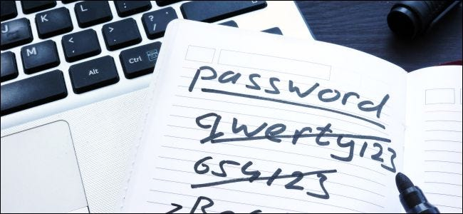 Crossed out passwords written in a notebook.