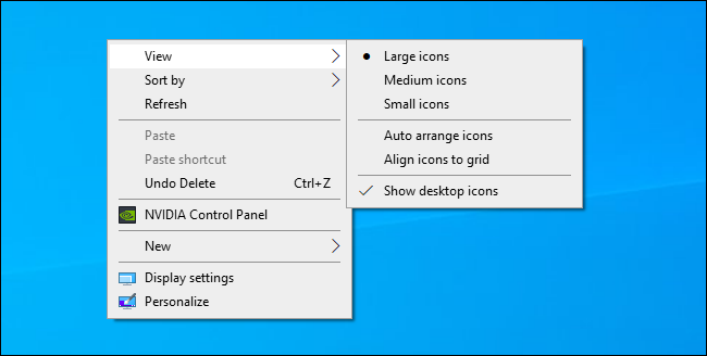 Choosing Windows desktop icon size from the desktop's context menu.