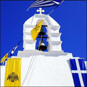 Beautiful white building with a Greek flag flying