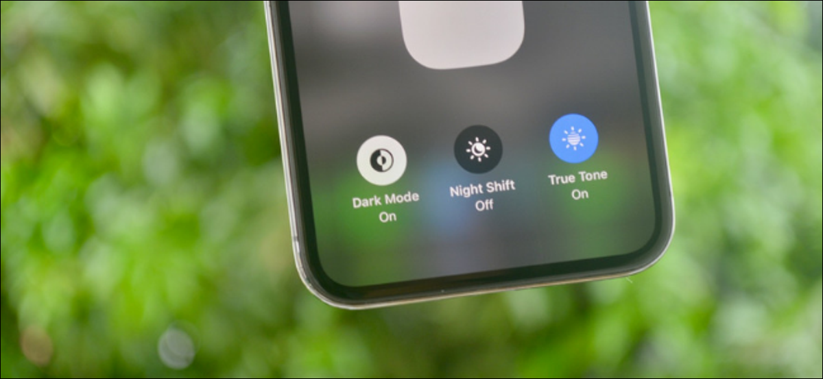 Dark Mode toggle in Control Center shown on an iPhone running iOS 13