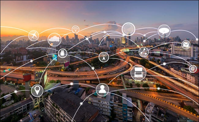 A city with a representation of many IOT devices connected over it.