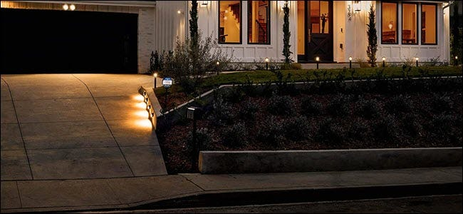 A series of ring smart lights lining a sidwalk path.