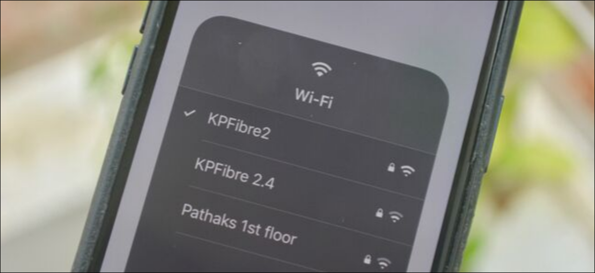 Selecting a different Wi-Fi network from the popup in Control Center on iPhone on iOS 13