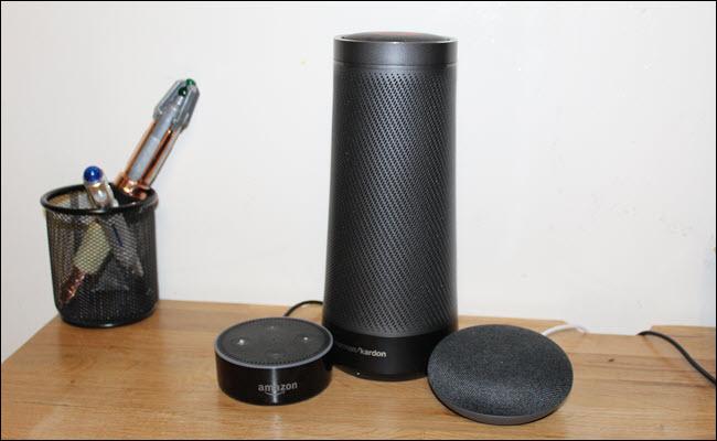 An Amazon Echo, Google Home Mini, and Harmon Kardon Invoke (Cortana speaker)