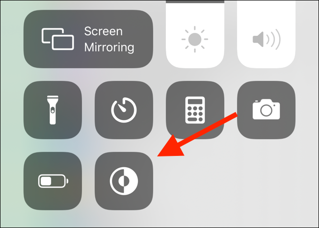 Tap on the new Dark Mode control in Control Center to quickly toggle the dark mode