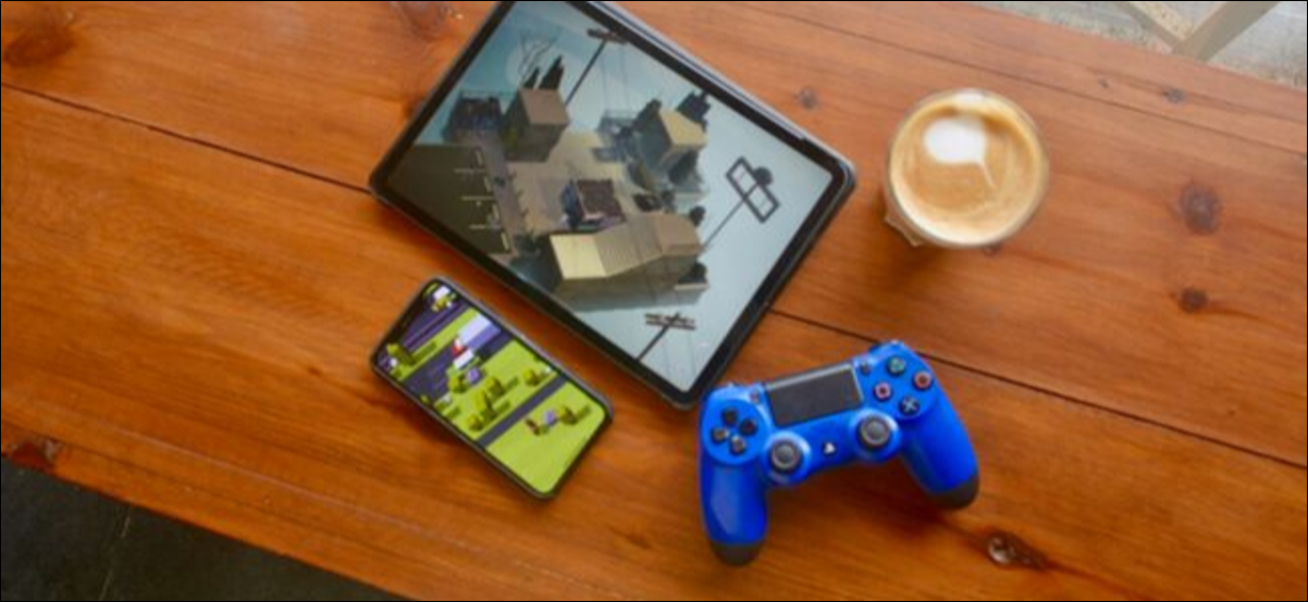 iPad Pro and iPhone on a table with a PS4 controller