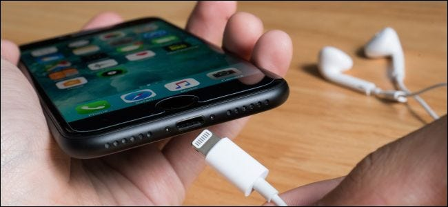 Connecting a Lightning cable to an iPhone