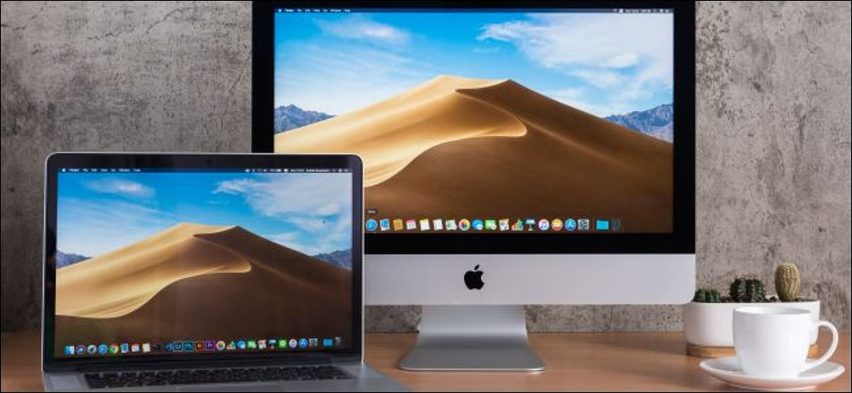 An iMac and MacBook on a desk.