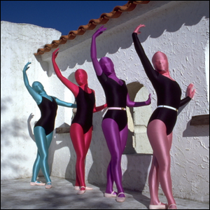 Four women wearing leotards and zentai suits