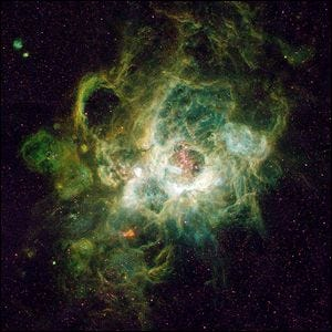 NGC 604, a vast nebula located in the neighboring spiral galaxy M33, in the constellation Triangulum