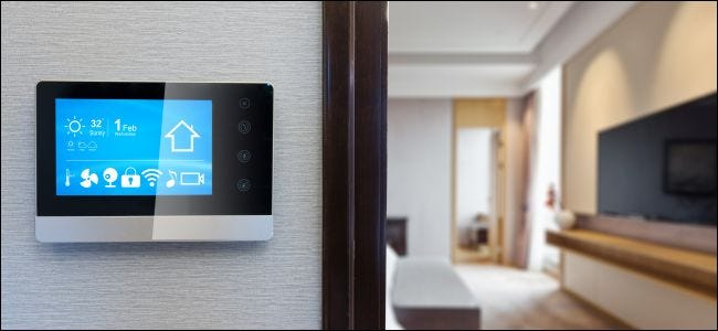 A digital smarthome control screen on a wall.