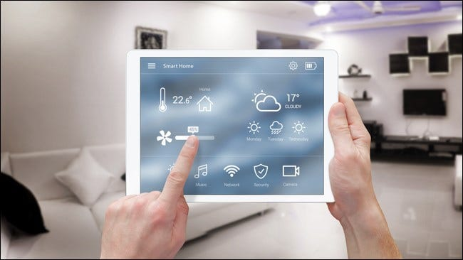 Hands using a Smart Home Automation on an iPad.