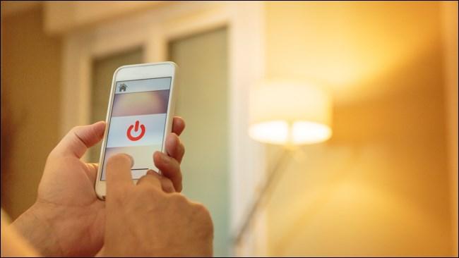 A hand using a Smart Light Controller on a Smartphone.