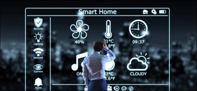 A confused man standing in front of smarthome controls.